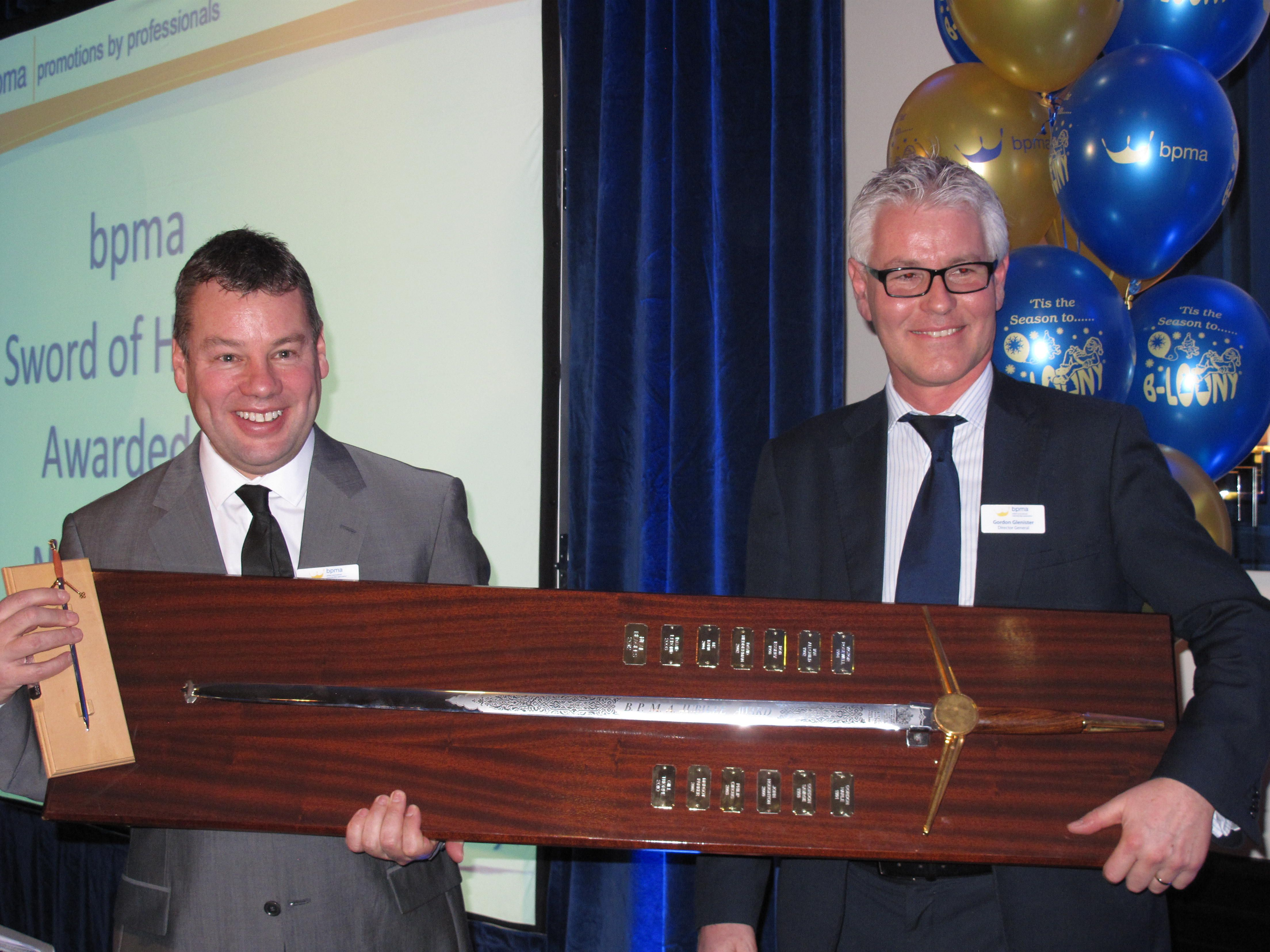 "BPMA-Director General Gordon Glenister (l) presents the ""Sword of Honour"" to Chairman Neal Beagles."