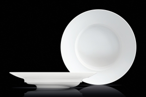 "crimex won a ""red dot"" for the slanted dish excentra, which enables every drop of soup to be spooned up."