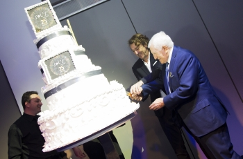 Sol's founder and CEO Alain Milgrom cutting the anniversary cake during the anniversary celebrations together with his father Salomon Milgrom.