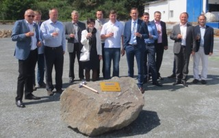 Sahm CEO of Michael Sahm (8th f.t.l.) celebrates the laying of the foundation stone ceremony with the people responsible for the construction project for the new logistics centre near Pilsen.